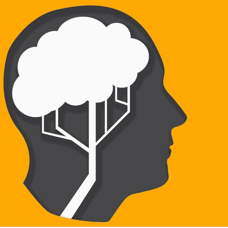 Orange background and face silhouette with thinking bubble