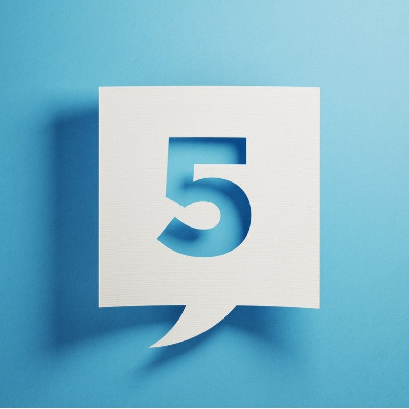 Blue background with white square number five cut-out